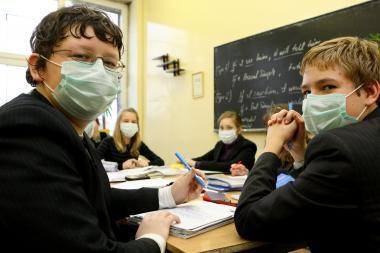 Trijose mokyklose dėl gripo nevyksta pamokos