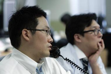 """Pasaulio akcijų biržos išgyveno """"juodąjį pirmadienį"""
