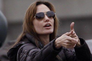 """A.Jolie lankė """"gerų manierų"""" pamokas"""