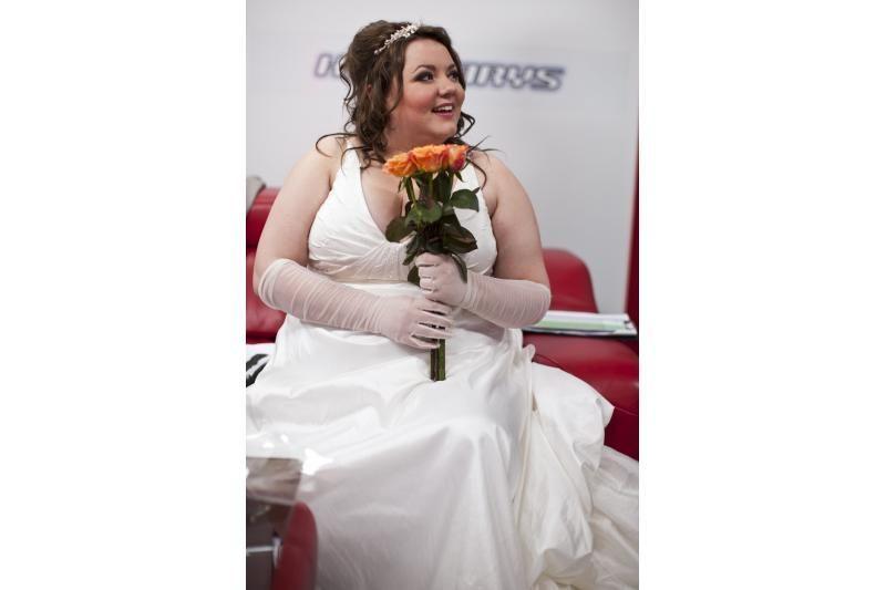 Raimondai Masiulytei vestuvinė suknelė tapo blogu pranašu