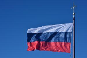 Nerimsta aistros dėl Rusijos vėliavos fone pozavusios šaulės