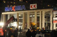 """Sužeistiems per """"Maximos"""" griūtį Rygoje išmokės 900 tūkst. eurų."""