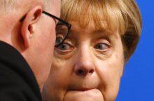 A. Merkel kyla į kovą su hidžabais
