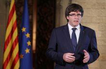 """C. Puigdemont'as nori """"be rizikos"""" grįžti į Ispaniją"""